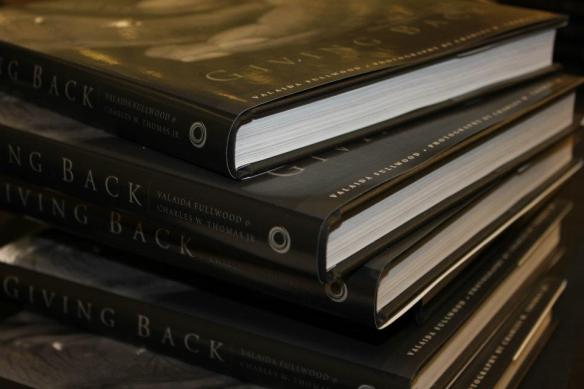 Stack of Giving Back books