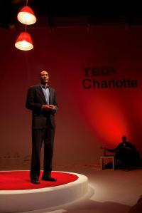 Charles Thomas presenting at TEDxCLT 2013, photography by Deborah Triplett