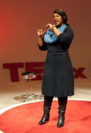 Valaida presenting during TEDxCLT 2013, photography by Deborah Triplett